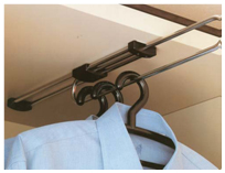 Sliding clothes hanger for shallow interior